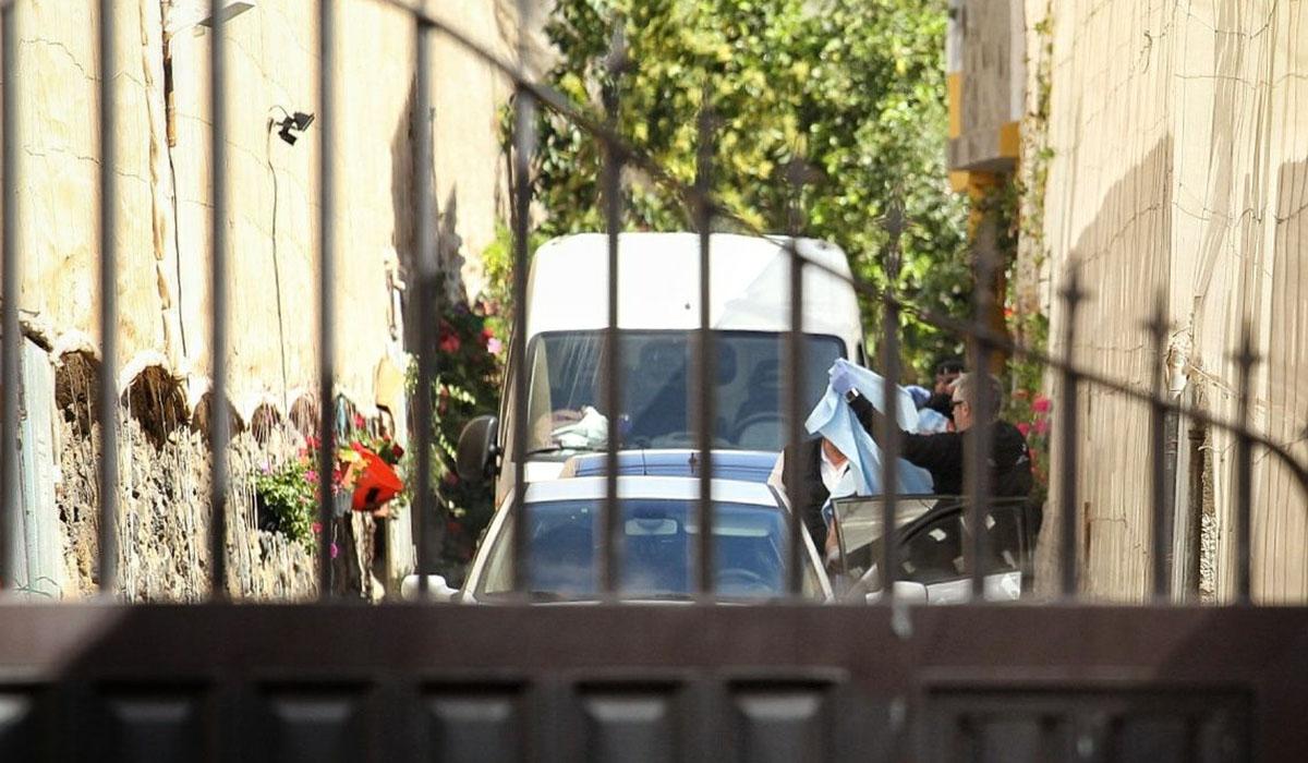 Momento del traslado del presunto autor del triple crimen. Andrés Gutiérrez